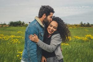 Kissing Couple In a Field - MAPIO Financial